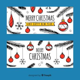 Hand drawn christmas banners with christmas balls