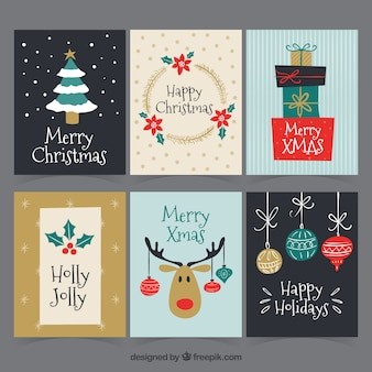 Hand drawn christmas cards Free Vector