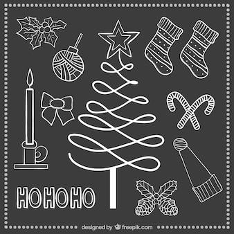 Hand drawn christmas elements on blackboard