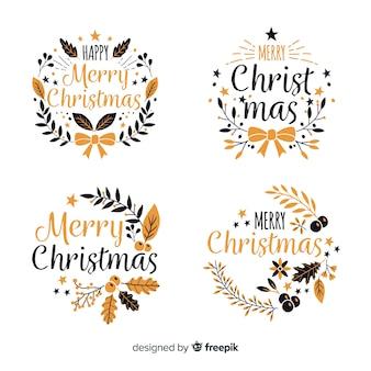 白い背景の上の手描きクリスマスラベルとバッジコレクション