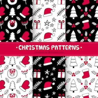 Hand drawn christmas patterns in red and black Free Vector