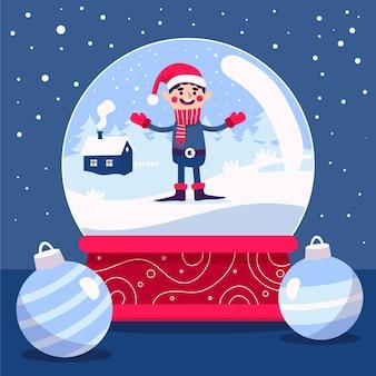 男と手描きのクリスマス雪玉地球儀