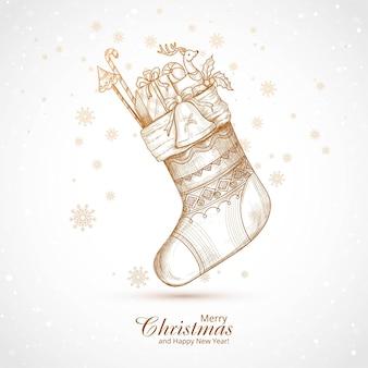 キャンディーとギフトの背景と手描きのクリスマスの靴下