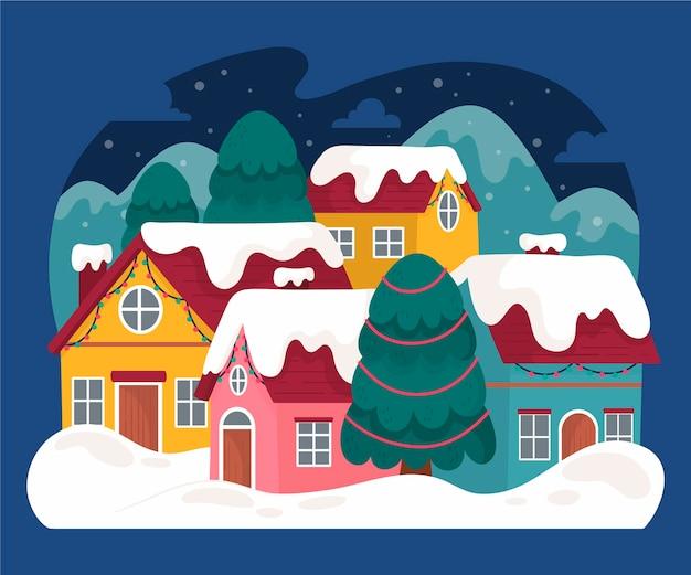雪の中で手描きのクリスマスの町