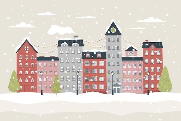 雪と手描きのクリスマスの町