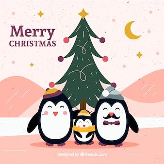 手描きのクリスマスツリーとペンギン