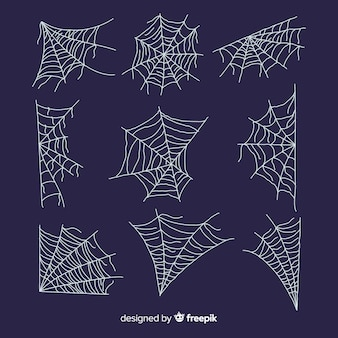 Hand drawn cobweb collection on blue background