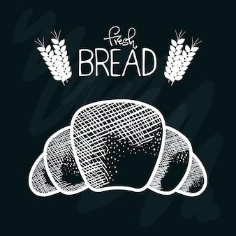 Ручной круассан со свежим знаком хлеба и пшеницей