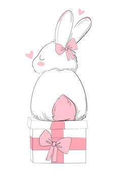 手描きのかわいいバニーと弓、プリントデザインのウサギ、子供たちのtシャツのプリント。ギフト用の箱。