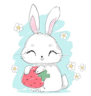 Ручной обращается милый кролик с клубникой и цветами