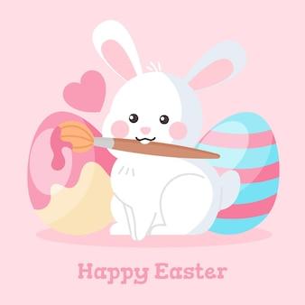페인트 브러시와 계란 손으로 그린 귀여운 부활절 토끼 그림