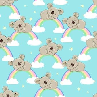 手描きのかわいいコアラと虹のシームレスパターン