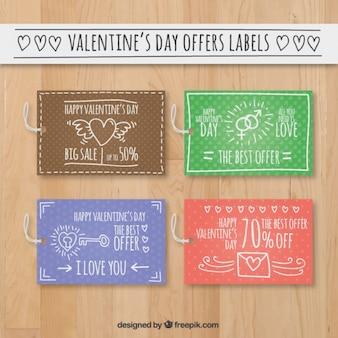 ハンドバレンタインの日のためのかわいい申し出ラベルを描か