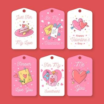 Insieme disegnato a mano sveglio dell'etichetta / distintivo di san valentino