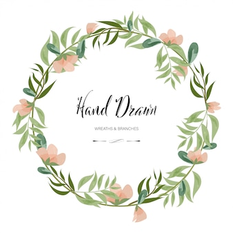 Hand drawn decoration painted watercolor wreath floral round frame leaves and branches.