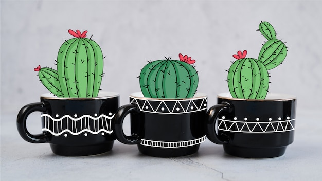 Hand drawn decorative cactus in several mugs