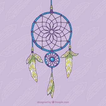 Hand drawn decorative dream catcher on a purple background