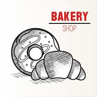 Ручной обратный пончик и круассан с табличкой с пекарным магазином