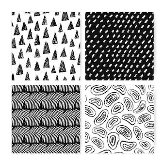 手描き落書き抽象的なシームレスパターンセット。さまざまなフリーハンドの形をした黒と白の背景のコレクション。