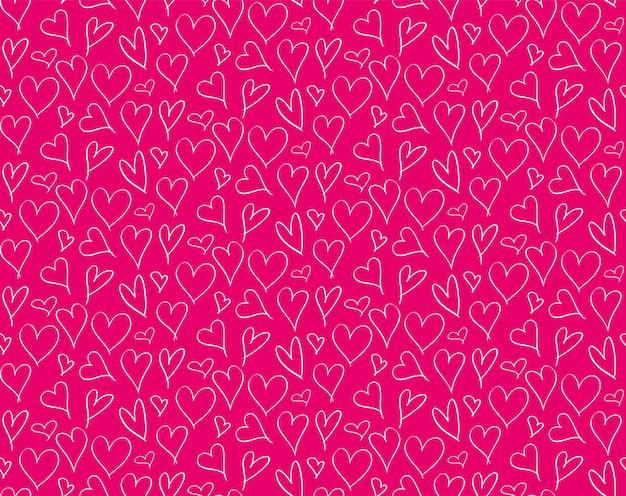 ハートで手描き落書きシームレスパターン。包みとプリントのデザインのためのかわいい赤いパターン。バレンタインデーのベクトルの心のシームレスな背景。