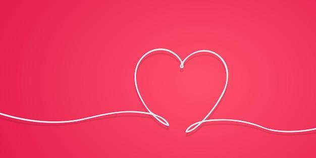 手描きの心の愛のシンボルを描く