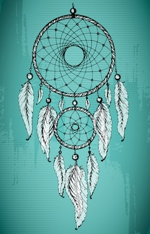 Hand drawn dream catcher with ornamental feathers on grunge green background.