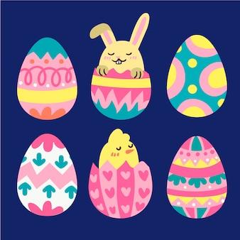 Uova di giorno di pasqua disegnate a mano con coniglio e pollo