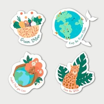 Distintivi di ecologia disegnati a mano con animali e piante