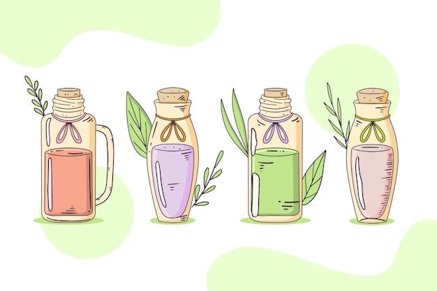 Collezione di bottiglie di olio essenziale disegnata a mano