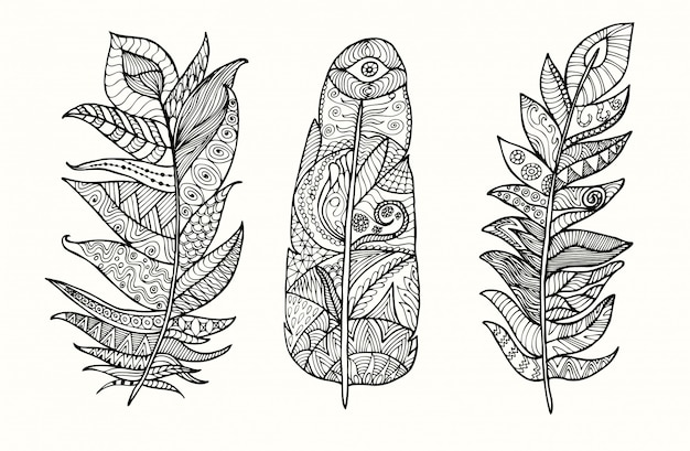 Hand drawn feather set with doodle, zentangle, floral, vintage elements.