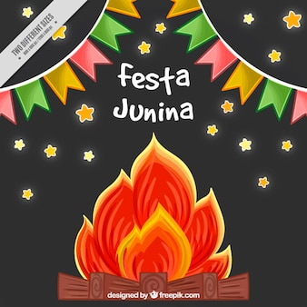 Hand drawn festa junina background with buntings and bonfire