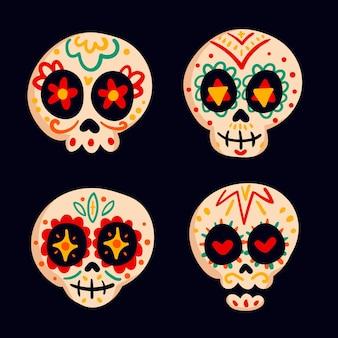 Collezione di teschi dia de muertos piatti disegnati a mano