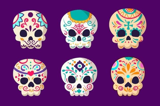 Hand drawn flat dia de muertos skulls collection