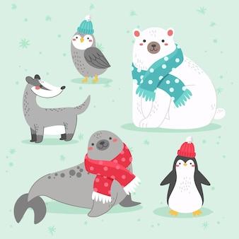 Коллекция рисованной плоских зимних животных