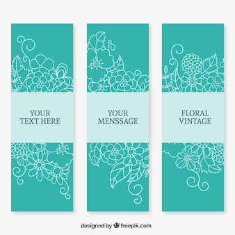 Hand drawn floral banners in turquoise color
