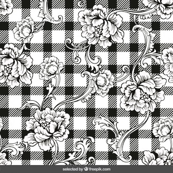 Hand drawn floral ornaments on gingham background