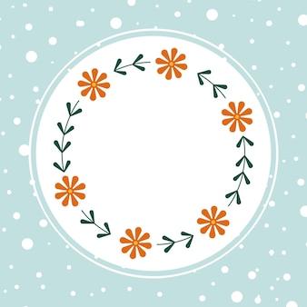 青い背景にオレンジ色のカモミールと手描きの花の楕円形フレームリース