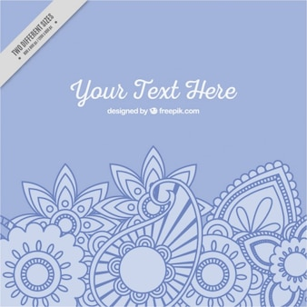 Hand drawn floral paisley blue background