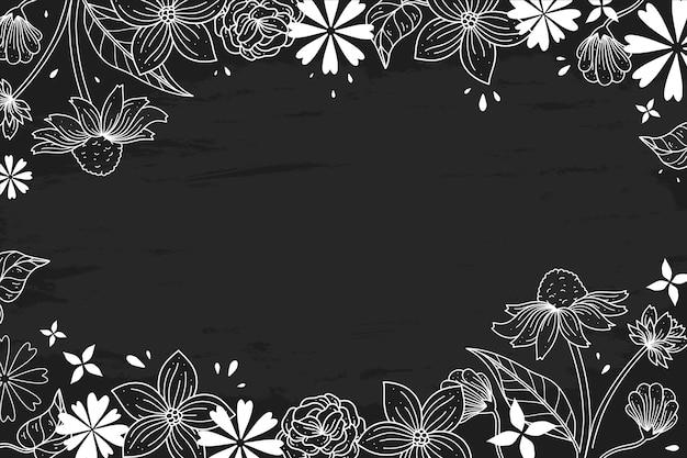 Hand-drawn flowers on blackboard concept