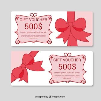 装飾的な赤いリボンと手描きのギフト券