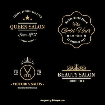 Hand drawn golden elegant hairdressing logos