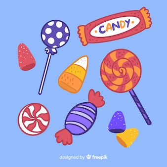 Hand drawn halloween candy collection on blue background