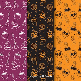 Hand drawn halloween pattern collection in negative