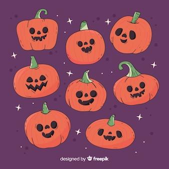 Hand drawn halloween pumpkin collection on violet background