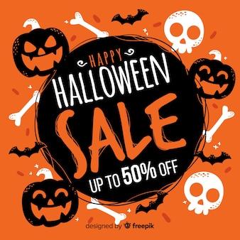 Hand drawn halloween sale with pumpkins and skulls Premium Vector