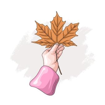 Hand drawn hand holding maple leaf 2