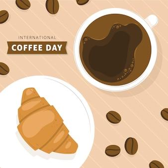 Giornata internazionale del caffè con croissant disegnata a mano