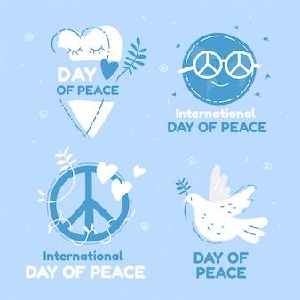 Collezione di badge per la giornata internazionale della pace disegnata a mano