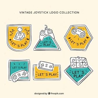 Рисованная коллекция логотипов джойстика с винтажным стилем