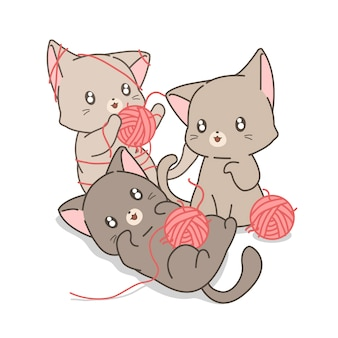Hand drawn kawaii cats are playing pink yarns and threads